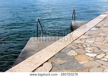 Traditional Stone Pier Leading To Two Smaller Concrete Piers With Inox Handrails For Easier Entrance