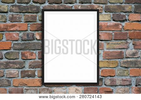 Blank Picture Frame Hanging On  Brick Wall -  Framed Poster Mock-up With Stone Wall Background