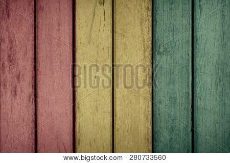 Guinea Politics News Concept: Guinean Flag Wooden Fence