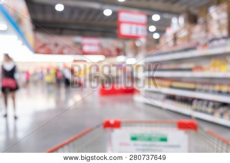 Abstract Blur Background Inside The Supermarket. Cart And Shopping In Supermarket Concept.