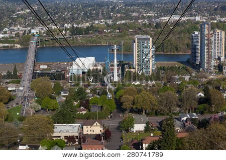 Portland, Oregon - April 14, 2014:  A Tram Car View Of City Buildings And Ross Island Bridge Crossin