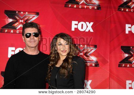 LOS ANGELES - DEC 19:  Simon Cowell, Melanie Amaro at the FOX's