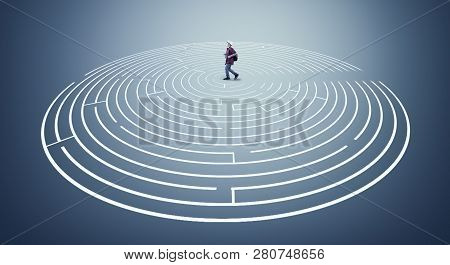 Man Running Through A Round Labyrinth. The Concept Of Shortcut And Working Smart.