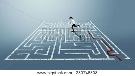 Businessman Running In A Labyrinth On The Right Path.