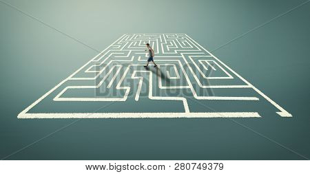 Man Walking In A Labyrinth Trying To Escape.