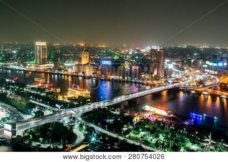 Cairo Egypt 25.05.2018 Aerial View Of Nile River And Bridge At Night Illuminated From Cairo Tower -