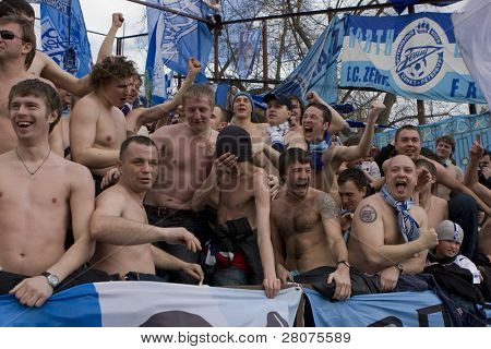 TOMSK, RUSSIA - APRIL 5:Football Club Zenit fans cheer their team at the match Championship of Russia among Tom'(Tomsk) - Zenit (Spb), April 5, 2009 in Tomsk, Russia.