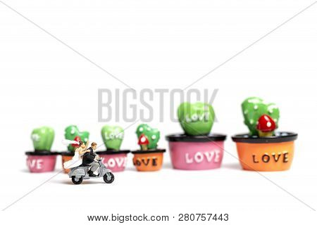 Couple Riding The Motorcycle In The Garden  , Valentine's Day Concept