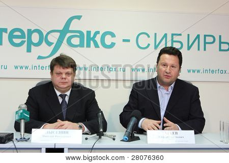 TOMSK, RUSSIA - DECEMBER 4: Manager office Tomsk Bank VTB-24 Nicholas Lysenin (L) and George Ageev (R) - Director of the National Philharmonic Orchestra of Russia, December 4, 2009 in Tomsk, Russia.