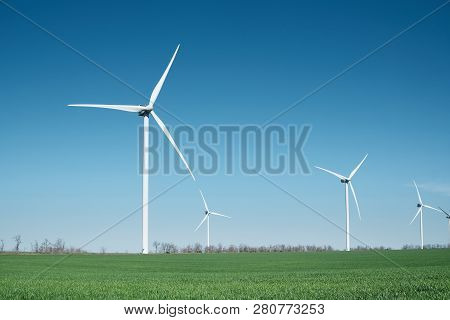 Wind Power Station On Field. Technology And Inovation. Green Energy Composition. Wind Turbines. Indu