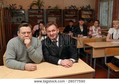 PODPOROZHYE, RUSSIA - FEBRUARY 2: Valery Serdyukov(L) governor of the Leningrad region and Petr Levin(R) -Mayor Podporozhye, in School 3 during a planned trip, February 2, 2010 in Podporozhye, Russia