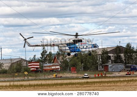 Yamal, Russia - August 2011: Passenger And Cargo Helicopter Mi-8t Takes Off From The Airfield. Freig