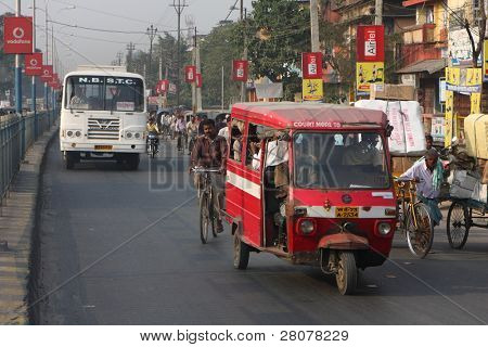SILIGURI, INDIA - DECEMBER 4: Streets Siliguri -is a city the transit point for air, road and rail traffic to of Nepal, Bhutan, Bangladesh and indian state Sikkim, December 4, 2008 in Siliguri, India.