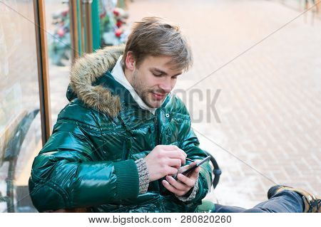 Communication Concept. Hipster Use Smartphone On Winter Day. Man Handsome Hold Smartphone. Man Unsha