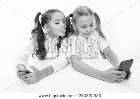 Having Fun. Happy Little Children Girls Having Fun At School With Mobile Phone. Digital Age Students