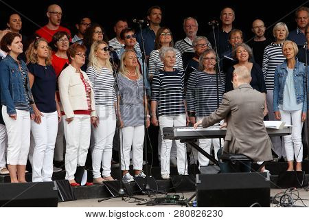 Strangnas, Sweden - May 20, 2017: The Singing Choir Lovsangarna Perform On An Outdoor Stage In The U