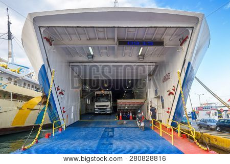 Piraeus, Greece - May 7, 2018: Car-ferry Docked In Seaport Near Athens. Large Ship In A Sea Harbor C