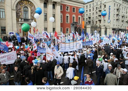 MOSCOW - MAY 1: People stands under pro-government banners and flags as United Russia party and government-linked trade unions take to the streets to mark May Day, May 1, 2010 in Moscow, Russia.
