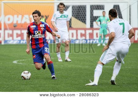 MOSCOW - MAY 10: CSKA's Evgeniy Aldonin (L) in action during their team's Russian football championship game CSKA (Moscow) vs. Terek (Grozny) - (4:1), May 10, 2010 in Moscow, Russia.