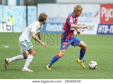 MOSCOW - MAY 10: CSKA's Keisuke Honda (R) in action during their team's Russian football championship game CSKA (Moscow) vs. Terek (Grozny) - (4:1), May 10, 2010 in Moscow, Russia.