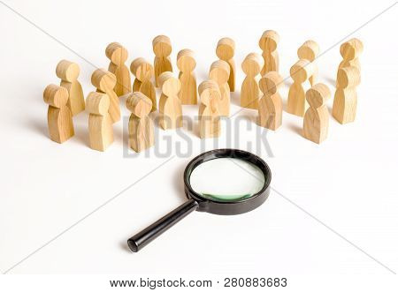 Wooden Figures Of People Look At The Magnifying Glass. Search For Answers To Questions, Searches For