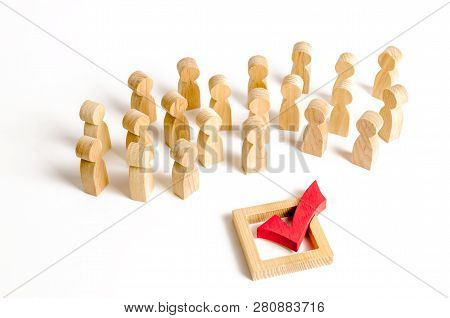 A crowd of people looks at a red check mark. Voting and election concept. Referendum, revolution. Peace and order, legitimization. Forcible overthrow. Making the right decision, majority agreement. poster