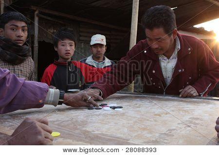KATHMANDU, NEPAL - JANUARY 7: An unidentified people play chips of a poor area at Old Baneshwor near Bagmati river, January 7, 2009 in Kathmandu Nepal.