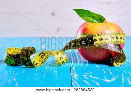 Apple With A Measuring Tape Around It