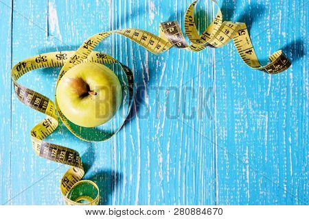 Apple With A Measuring Tape Around It Top View