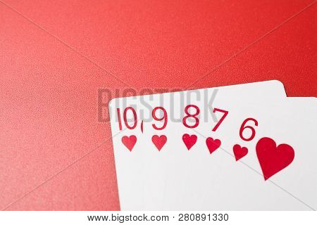 Poker hands playing cards straight flush on a red background poster