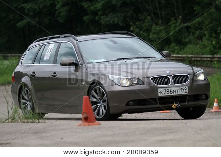DMITROV, RUSSIA - JUNE 13: A unidentified participant in BMW in the first Championship 'Rus Hill climb Open' at avtopoligone NIITSAMT, June 13, 2010 in Dmitrov, Russia.