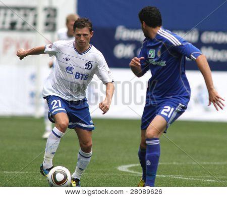 MOSCOW - JULY 3: Dinamo's midfielder Igor Semshov (left) in the VTB Lev Yashin Cup: FC Dynamo Moscow vs. FC Dynamo Kyiv (2:0), July 3, 2010 in Moscow, Russia.