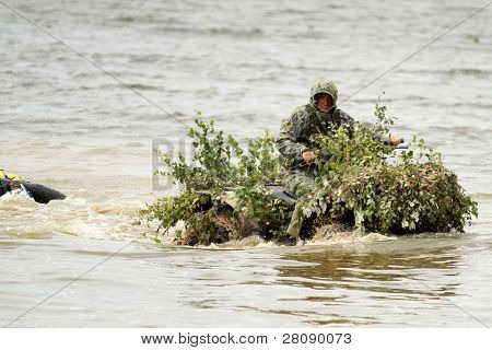 KOSTROMA REGION - AUGUST 26: Buggy and Quads with divers-saboteurs on the Command post exercises with 98-th Guards Airborne Division, August 26, 2010 in Kostroma region, Russia.