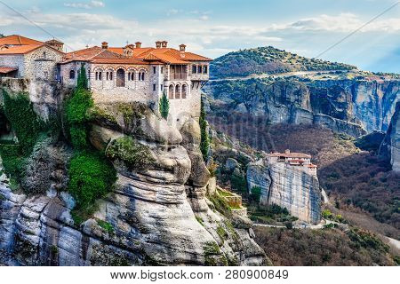 Varlaam Monastery Located On The Huge Rock And Roussanou Women Monastery Below In The Background, Ka