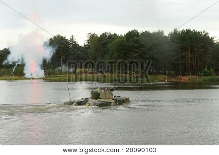 KOSTROMA REGION - AUGUST 26: Crossing lake Pesochnoe unidentified military equipment on Command post exercises with 98-th Guards Airborne Division, August 26, 2010 in Kostroma region, Russia.