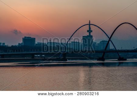 Daejeon,south Korea; January 17, 2019; Pink And Red Hues In Sky Behind Bridge And Double Arches In E