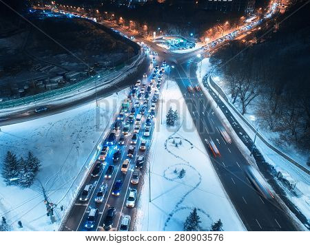 Aerial View Of Road In The City At Night In Winter. Top View Of Traffic In Road With Illumination. L