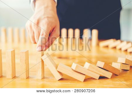 Businessman Plan And Strategy In Business Domino Effect Problem Solving