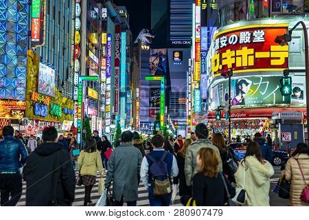 Shinjuku, Tokyo, Japan - December 24, 2018: Crowd Pedestrians People Walking On Crosswalk At Shinjuk