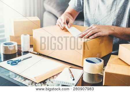 Sme Freelance Man Working With Packaging Startup Entrepreneur Small Business Owner At Home,online Bu