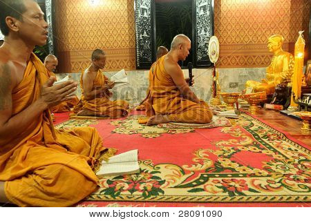 KOH CHANG, THAILAND - DECEMBER 5: Recitation of mantras by monks in a Buddhist monastery Wat Klong Prao, on the occasion of the birth of King of Thailand, December 5, 2011 in Koh Chang, Thailand.