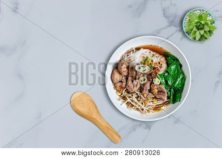 Bowl Of Asian Noodles With Vegetables And Pak
