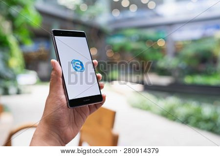 Chiang Mai, Thailand - May 05,2018: Man Holding Huawei With Skype Apps. Skype Is Part Of Microsoft,