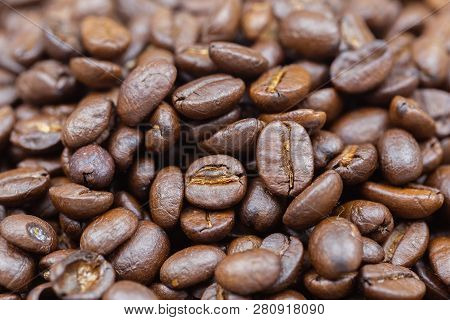 Brown Roasted Coffee Beans For Food And Drink Design. Coffee Beans Texture Or Coffee Beans Backgroun