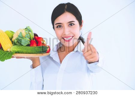 Woman Nutritionist Presenting Diet Food Of Fruit And Vegetables For Cholesterol Control Showing Awar