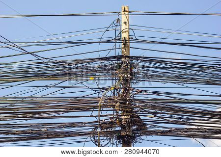 Wire and cable clutter. Potential danger from a mess of wires at Thailand. poster