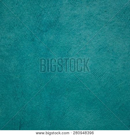 background of turquoise Huun Mayan handmade paper created  by Mayan artisans throughout the Yucatan Peninsula of Mexico