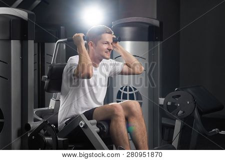 Closeup Idoor Portrait Of Ypung Attractive Fit Concentrated Sirious Sportsman In Gym. Strong Smiling