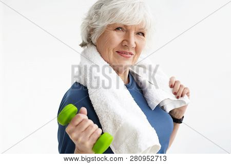Strength, Energy, Wellness And Healthy Active Lifestyle Concept. Stylish Athletic Senior Female With
