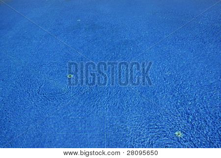 swimming pool blue water detail with textures